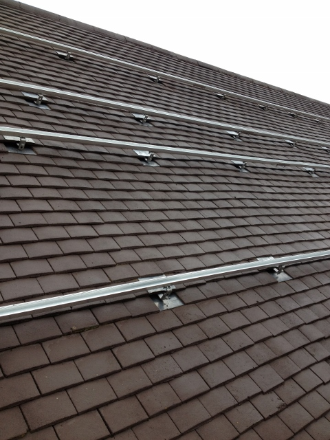 An example of solar panel rails mounted into a Plain Tile Roof